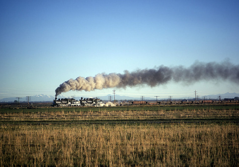 """May 28, 1968.  The first train of the last year.  The 476 and 478 had been overhauled at Alamosa while the line was closed for the winter.  The snow had melted and it was time to get them to Durango for the Silverton season.  A short train of pipe was assembled for a one day """"mad dash"""" through to Durango, skipping the usual overnight stay at Chama."""