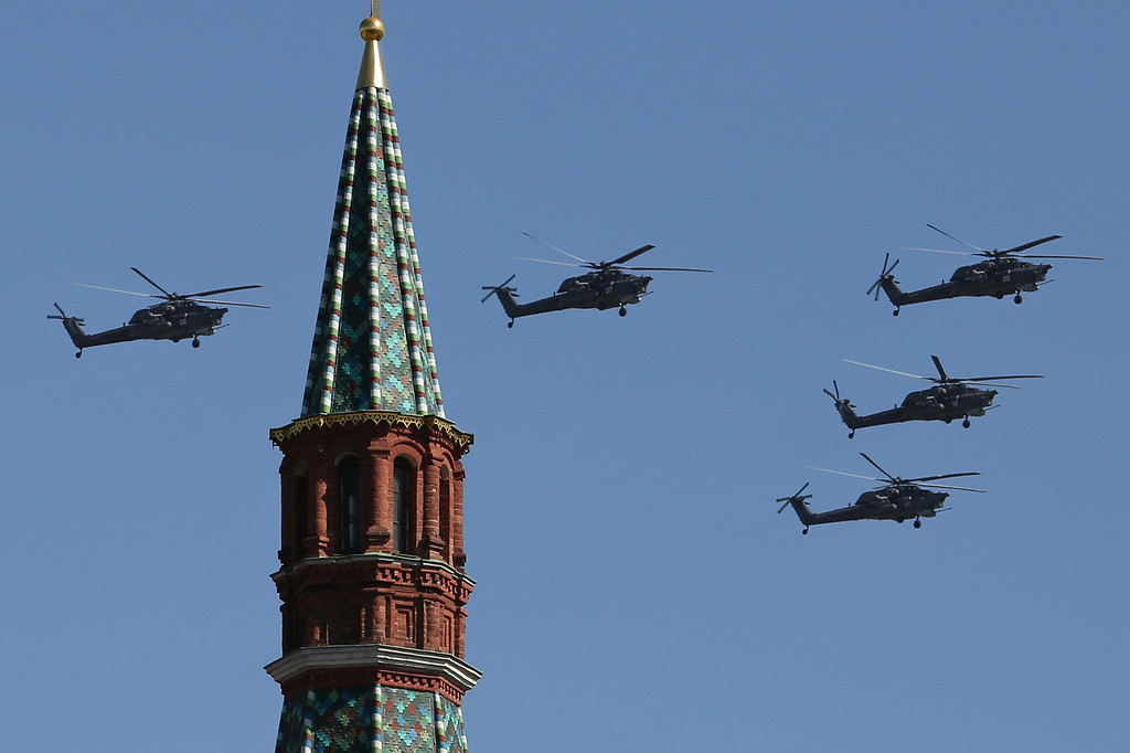 . Russian Air Force Mi-28 helicopters fly over Red Square during a Victory Day parade, which commemorates the 1945 defeat of Nazi Germany, in Moscow, Russia, Friday, May 9, 2014. Russia marked the Victory Day on May 9 holding a military parade at Red Square. (AP Photo/Denis Tyrin)
