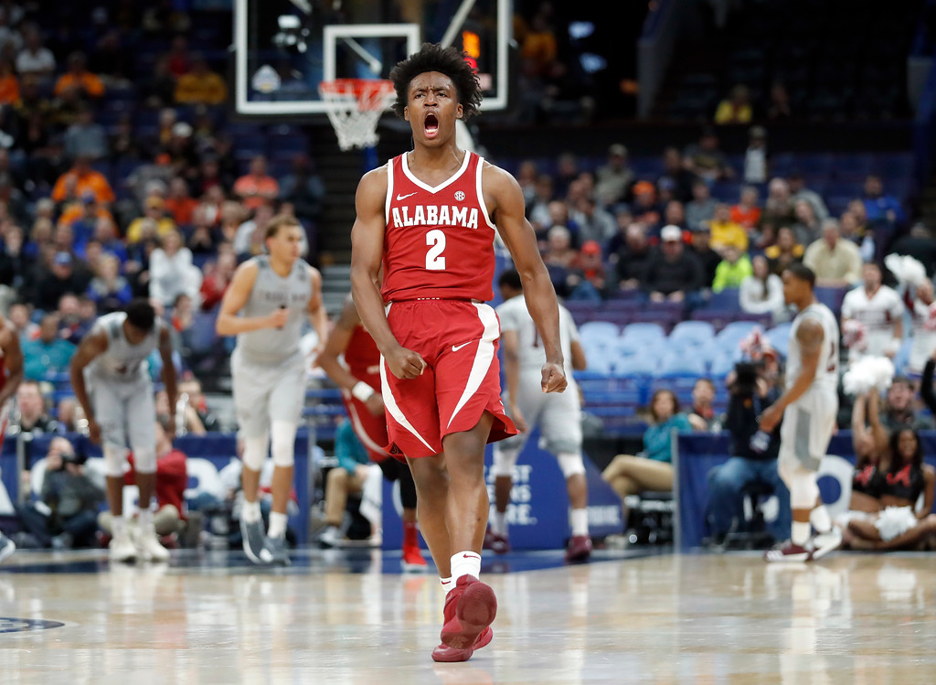 . Alabama\'s Collin Sexton celebrates after a teammate\'s basket during the second half in an NCAA college basketball game against Texas A&M at the Southeastern Conference tournament Thursday, March 8, 2018, in St. Louis. Alabama won 71-70. (AP Photo/Jeff Roberson)
