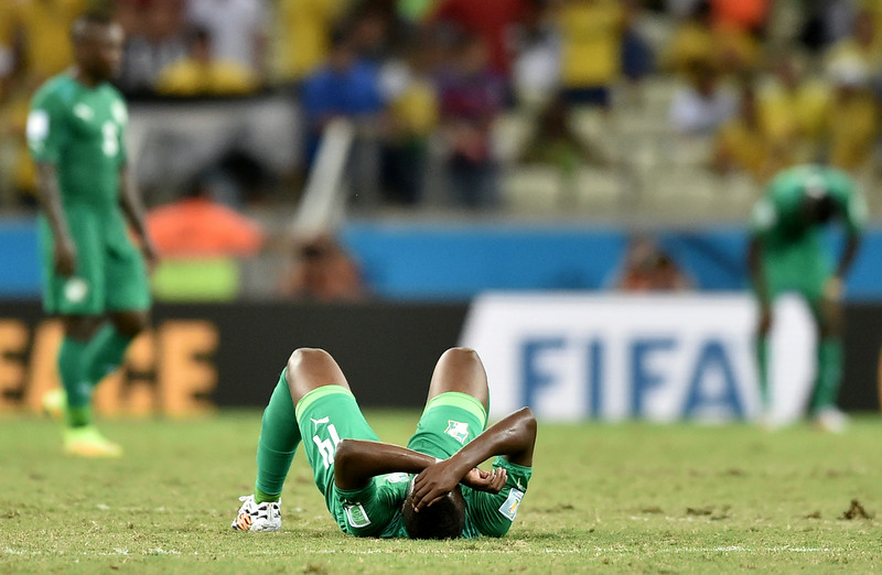 . Ivory Coast\'s midfielder Ismael Diomande reacts at the end of the Group C football match between Greece and Ivory Coast at the Castelao Stadium in Fortaleza during the 2014 FIFA World Cup on June 24, 2014. Greece won 2-1.  (ARIS MESSINIS/AFP/Getty Images)