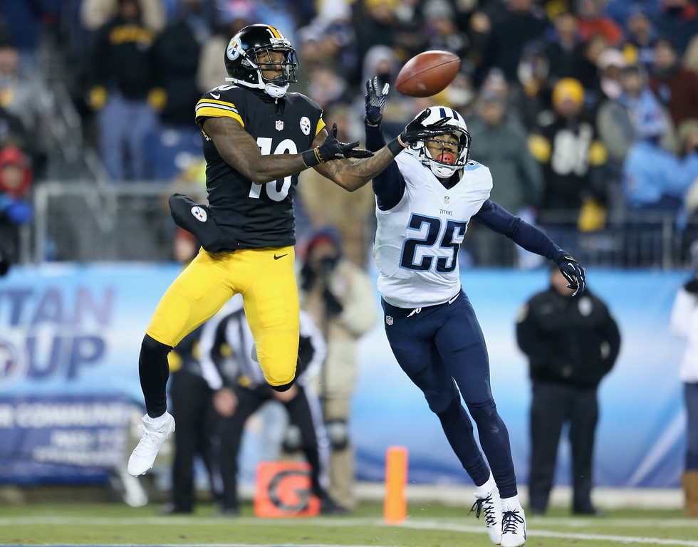 . NASHVILLE, TN - NOVEMBER 17:  Martavis Bryant #10 of the Pittsburgh Steelers makes an attempt to catch a pass while defended by Blidi Wreh-Wilson #25 of the Tennessee Titans in the second quarter at LP Field on November 17, 2014 in Nashville, Tennessee.  (Photo by Andy Lyons/Getty Images)