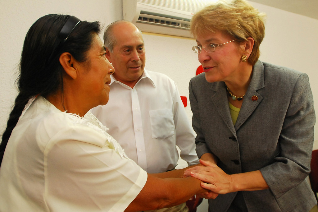 . Rep. Marcy Kaptur, D-Ohio, right,  shakes hands with Epifania Rafael Cruz during the opening of the Justice Center at the Farm Labor Organizing Committee, FLOC, office in Monterrey, Mexico, Saturday, June 30, 2007.   FOLC?s president Baldemar Velasquez is seen at the center. (AP Photo/Monica Rueda)