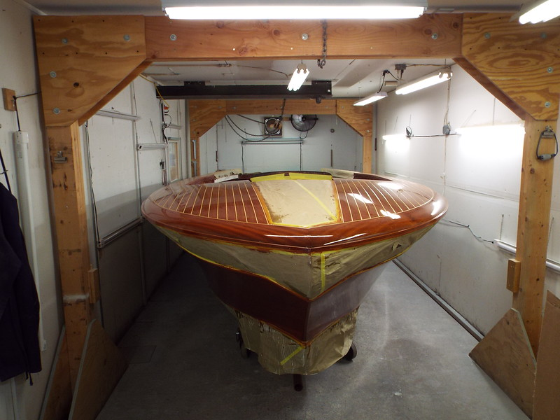 Moving the boat in the finish room so we can paint he white on the hull.