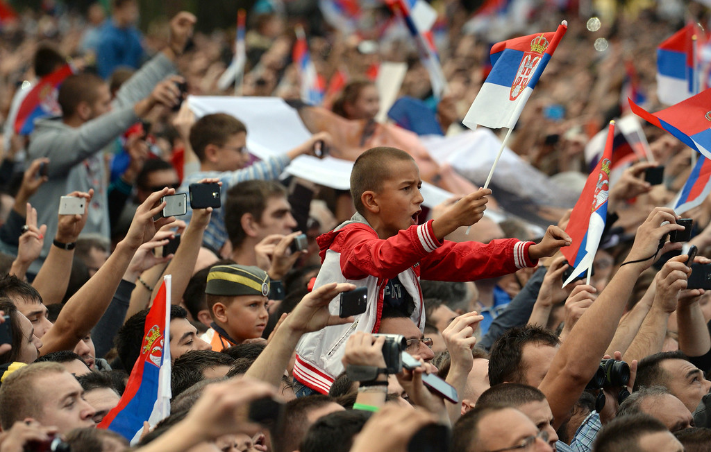 . Serbian people react during a military parade in the Serbian capital Belgrade on October 16, 2014 in Belgrade. VASILY MAXIMOV/AFP/Getty Images