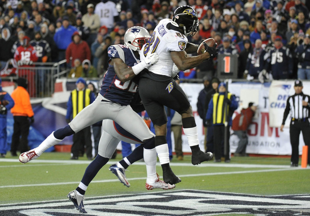 Description of . Baltimore Ravens wide receiver Anquan Boldin (R) scores a touchdown while being covered by New England Patriots free safety Devin McCourty during the fourth quarter in the NFL AFC Championship football game in Foxborough, Massachusetts January 20, 2013. REUTERS/Ray Stubblebine