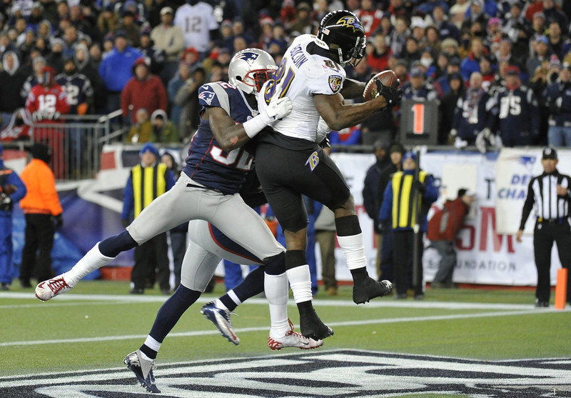 . Baltimore Ravens wide receiver Anquan Boldin (R) scores a touchdown while being covered by New England Patriots free safety Devin McCourty during the fourth quarter in the NFL AFC Championship football game in Foxborough, Massachusetts January 20, 2013. REUTERS/Ray Stubblebine