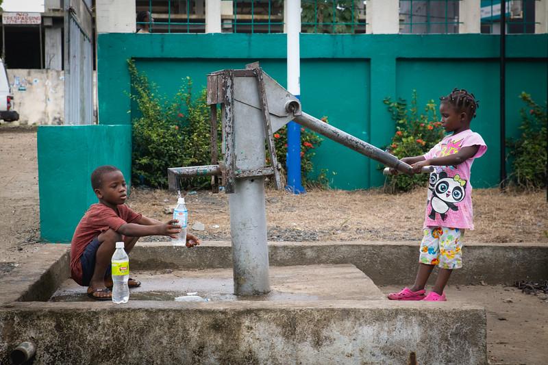 Monrovia, Liberia October 13, 2017 - Sreet scene with kids at water pump.