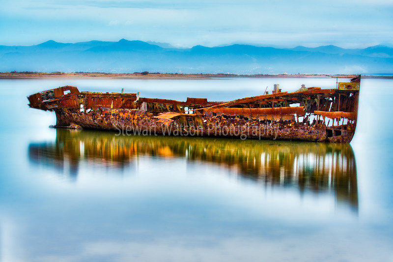 Reflections of the beautiful ruins of the  Janie Seddon shipwreck at Port Motueka in New Zealand