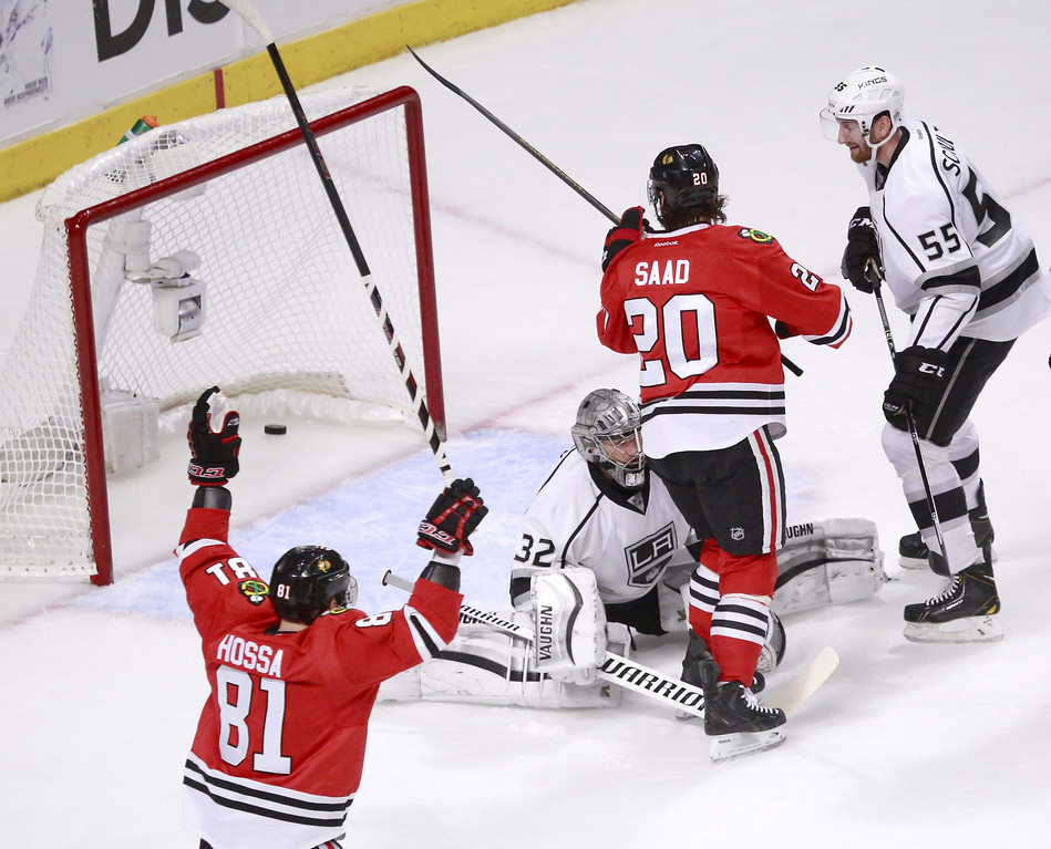 . Chicago Blackhawks right wing Marian Hossa (81) celebrates Brandon Saad\'s goal past Los Angeles Kings goalie Jonathan Quick, as Jeff Schultz (55) watches  during the first period of Game 1 of the Western Conference finals in the NHL hockey Stanley Cup playoffs in Chicago on Sunday, May 18, 2014. (AP Photo/Charles Rex Arbogast)