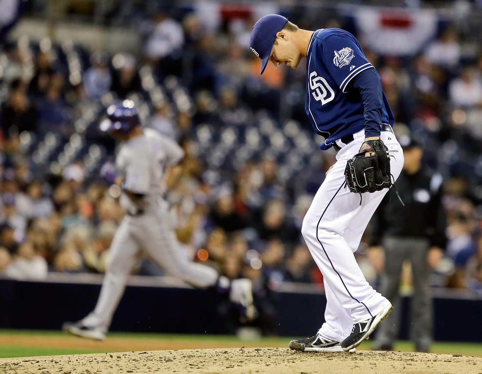 . San Diego Padres relief pitcher Thad Weber, making his first appearance since being called up from the minors, kicks the dirt as Colorado Rockies\' Michael Cuddyer rounds the bases with a two-run homer in the fourth inning of a baseball game, Saturday April 13, 2013, in San Diego. (AP photo/Lenny Ignelzi)