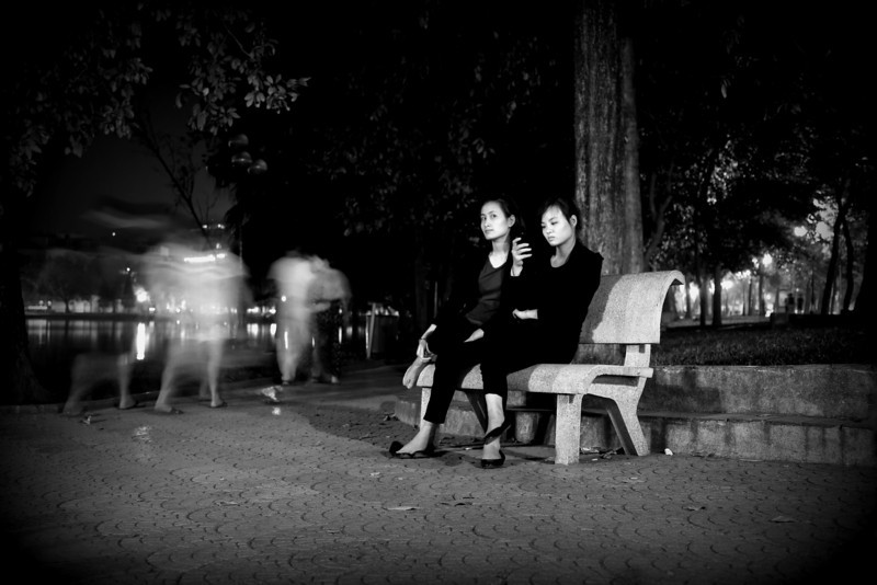 enjoying the evening by Hoan Kien Lake, Hanoi, Vietnam