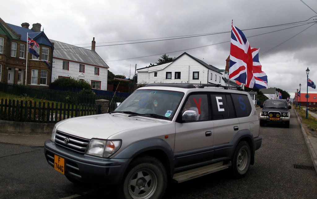 ". A vehicle with the word ""Yes\"" stamped on its windows drives by on Ross road during a parade in Stanley, March 10, 2013. Voters in the remote British-ruled Falkland Islands hold a referendum on their future today that seeks to challenge Argentina\'s increasingly vocal sovereignty claim. REUTERS/Marcos Brindicci"