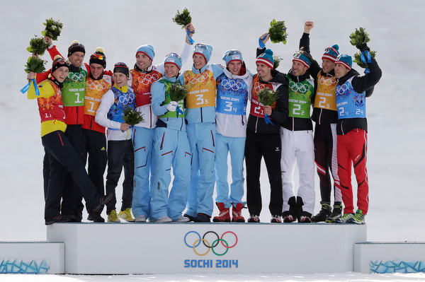 . Germany\'s silver medal winning team Eric Frenzel, Bjoern Kircheisen, Johannes Rydzek and Fabian Riessle, Norway\'s gold medal winning team Magnus Hovdal Moan, Haavard Klemetsen, Magnus Krog and Joergen Graabak and Austria\'s bronze medal winning team Lukas Klapfer, Christoph Bieler, Bernhard Gruber and Mario Stecher, from left, pose on the podium during the flower ceremony of the Nordic combined Gundersen large hill team competition at the 2014 Winter Olympics, Thursday, Feb. 20, 2014, in Krasnaya Polyana, Russia. (AP Photo/Matthias Schrader)