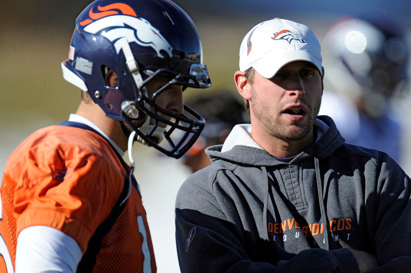 . Denver Broncos quarterback Tim Tebow (15) talks with coach Adam Gase during practice January 10, 2012 at Dove Valley. John Leyba, The Denver Post