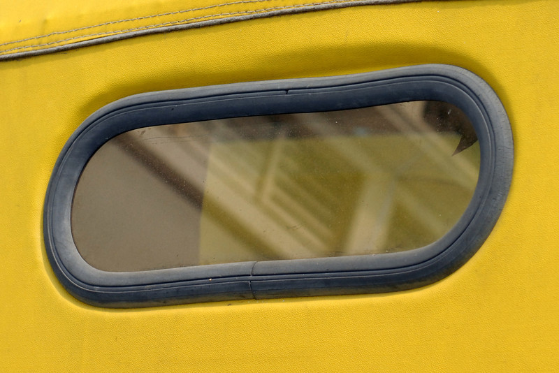 Back window of a motorized rickshaw.