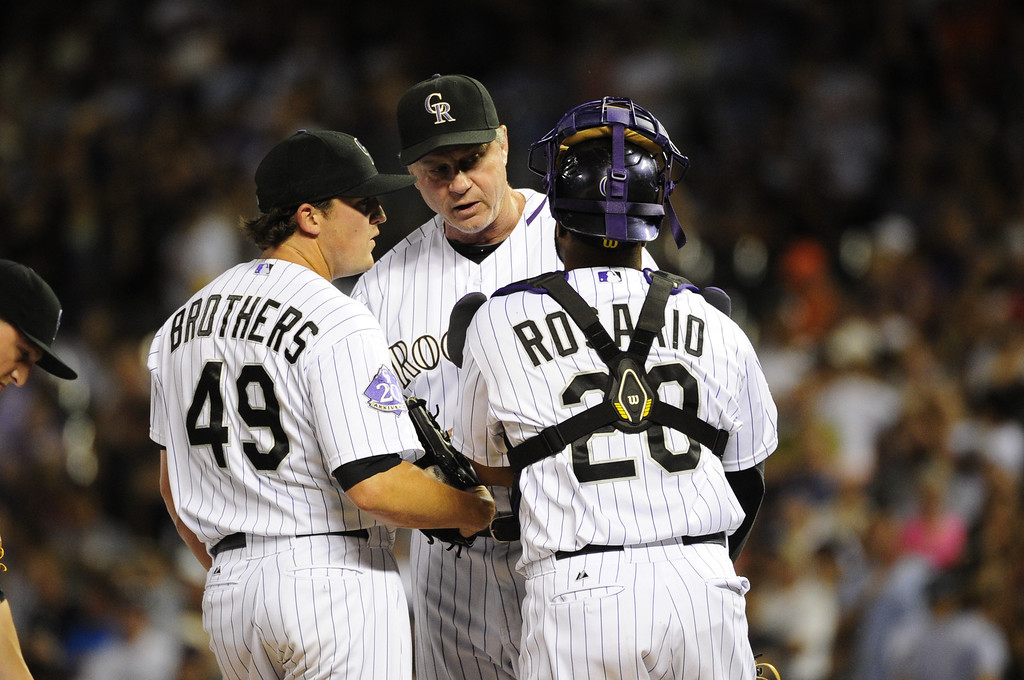 . DENVER - JUNE 28: Jim Wright #52, Rockies Head Pitching Coach, talks to Rex Brothers #49 and Wilin Rosario #20, during the ninth inning of a baseball game against the San Francisco Giants on June 28, 2013 at Coors Field.  (Photo By Grant Hindsley / The Denver Post)