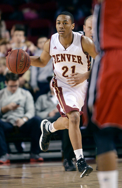 . DENVER, CO. - FEBRUARY 8, 2014: Denver sophomore guard Bryant Rucker (21) controlled the ball in the second half. The University of Denver defeated South Dakota 75-67 Saturday evening, February 8, 2014. Photo By Karl Gehring/The Denver Post