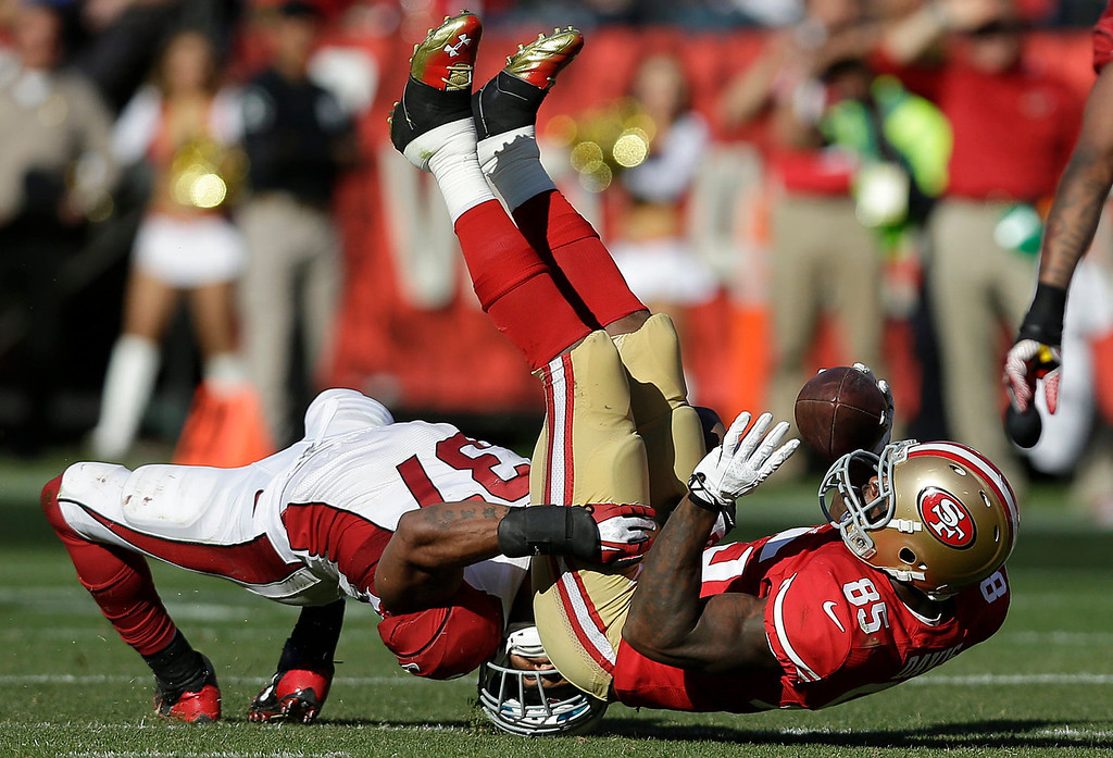 . San Francisco 49ers tight end Vernon Davis (85) is tackled by Arizona Cardinals strong safety Yeremiah Bell (37) during the fourth quarter of an NFL football game in San Francisco, Sunday, Oct. 13, 2013. (AP Photo/Marcio Jose Sanchez)