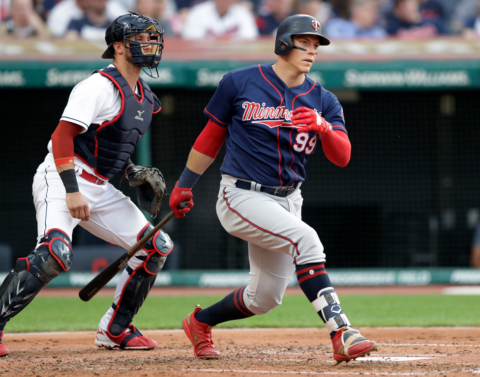 . Minnesota Twins\' Logan Morrison watches his grounder during the fourth inning of a baseball game against the Cleveland Indians, Friday, June 15, 2018, in Cleveland. Morrison was safe at first, and Eddie Rosario scored on a throwing error by Francisco Lindor on the play. Catcher Yan Gomes is at left. (AP Photo/Tony Dejak)