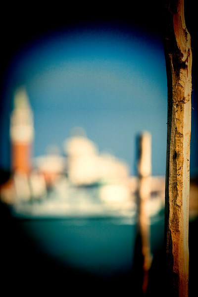 Posts for mooring gondolas in front of San Giorgio Maggiore (defocused on the background), Venice, Italy