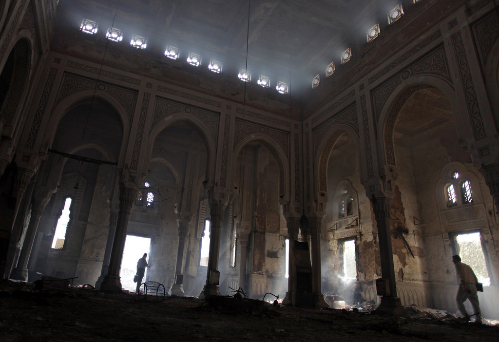 . Aug. 15, 2013: Egyptians tour the inside of the charred Rabaah al-Adawiya mosque, where supporters of Egypt\'s ousted President Mohammed Morsi had a camp at Nasr City, Cairo, Thursday, Aug. 15, 2013. The Interior Ministry authorized police to use deadly force against protesters targeting police and state institutions after Islamists torched government buildings, churches and police stations in retaliation against the crackdown on their encampments. (AP Photo/Khalil Hamra)
