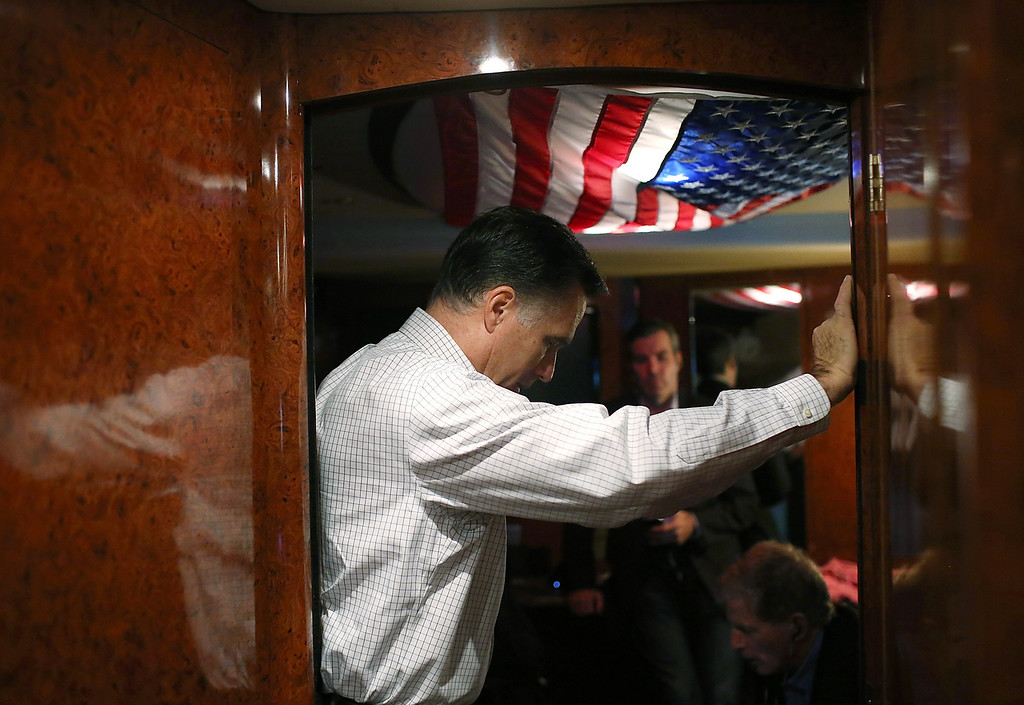 . Republican presidential candidate, former Massachusetts Gov. Mitt Romney listens in on conference call with advisors aboard his campaign bus en route to a campaign rally at Avon Lake High School on October 29, 2012 in Avon Lake, Ohio. Romney has canceled other campaign events on October 29 and 30 due to Hurricane Sandy.  (Photo by Justin Sullivan/Getty Images)