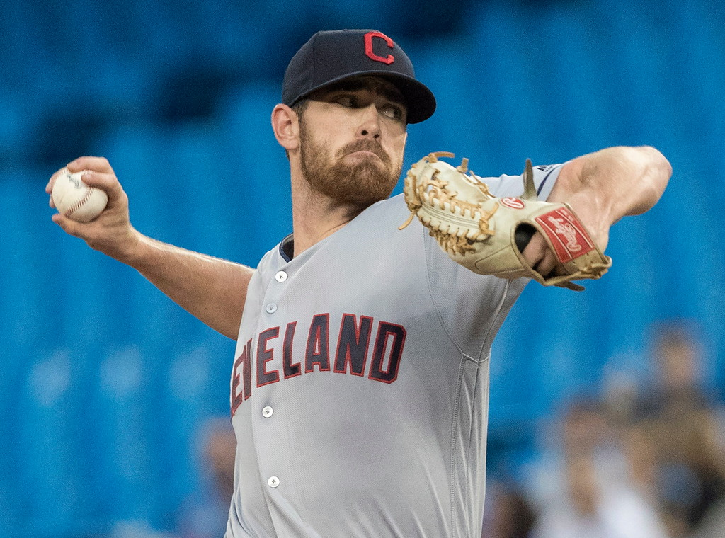 . Cleveland Indians starting pitcher Shane Bieber throws to a Toronto Blue Jays batter during the first inning of a baseball game Thursday, Sept. 6, 2018, in Toronto. (Fred Thornhill/The Canadian Press via AP)