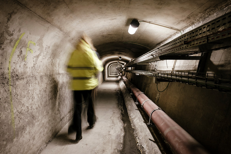 Erika Noro (communication service) walking inside the underground evacuation tunnel, from emergency shelter number 17, looking towards France - Samuel Zeller for the New York Times