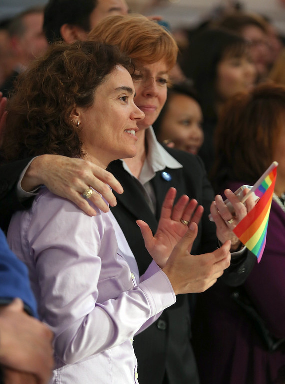 """. Zoe Dunning, left, and her partner Pam Grey, of San Francisco, celebrate as they watch a screening of the Supreme Court\'s decision on Proposition 8 and the Defense of Marriage Act. at City Hall in San Francisco, Calif., on Wednesday, June 26, 2013. Dunning is vice-chair of the San Francisco Democratic party and a former military officer who crusaded against the \""""Don\'t Ask, Don\'t Tell\"""" policy. The U.S. Supreme Court dismissed California\'s Proposition 8 and declared the 1996 Defense of Marriage Act unconstitutional. (Jane Tyska/Bay Area News Group)"""