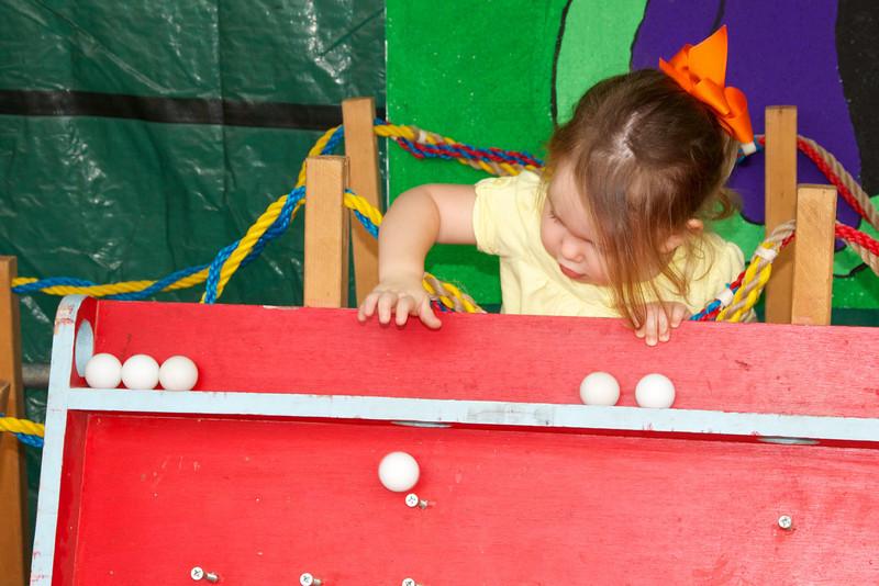 Sending her pingpong ball down the peg board