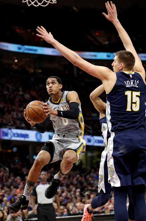 . Cleveland Cavaliers\' Jordan Clarkson (8) drives to the basket against Denver Nuggets\' Nikola Jokic, from Serbia, in the first half of an NBA basketball game, Saturday, March 3, 2018, in Cleveland. (AP Photo/Tony Dejak)