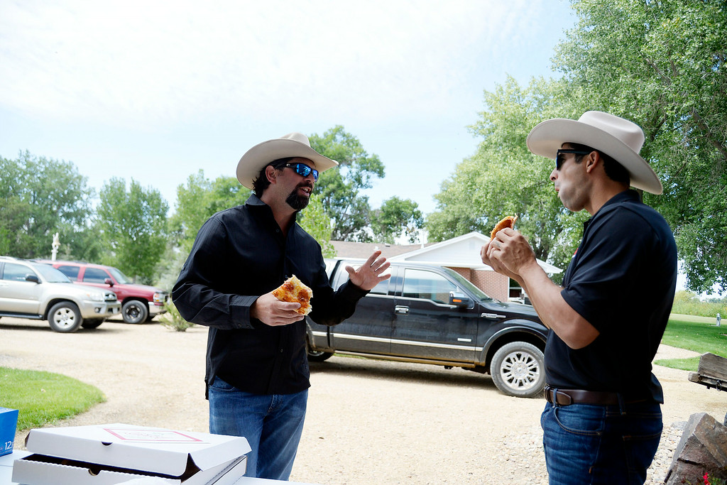 . KERSEY, CO - AUGUST 14: Todd Helton jokes with former teammate Ryan Spilborghs as they eat pizza from Helton\'s favorite pizza joint Kersey Pizza. Former Colorado Rockies first baseman Todd Helton was photographed at his ranch on Thursday, August 14, 2014. (Photo by AAron Ontiveroz/The Denver Post)