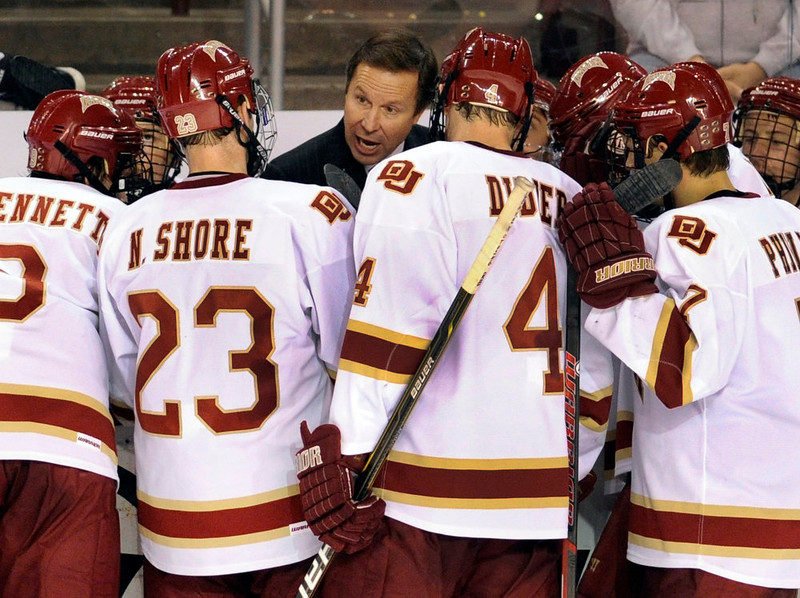 . Pioneers coach George Gwozdecky made use of a time out Saturday night. The University of Denver hockey team tied the University of Nebraska Omaha 3-3 at Magness Arena Saturday night, November 19, 2011. Karl Gehring, The Denver Post