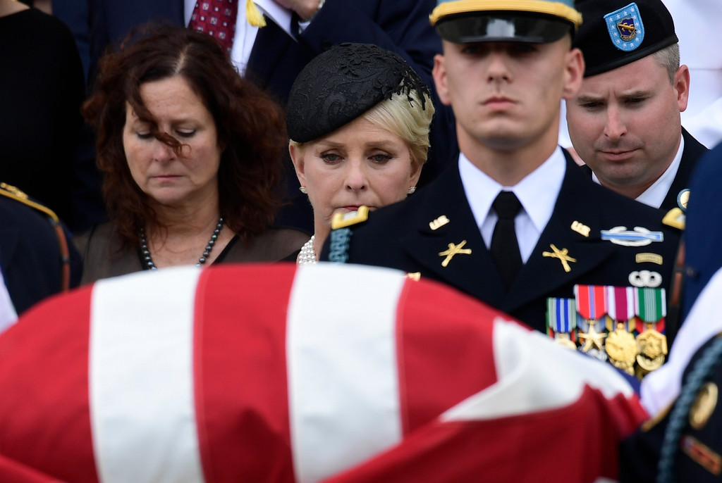 . Cindy McCain, center, widow of Sen. John McCain, R-Ariz., follows his casket as it is carried out of Washington National Cathedral in Washington, Saturday, Sept. 1, 2018, following a memorial service. McCain died Aug. 25 from brain cancer at age 81. (AP Photo/Susan Walsh)
