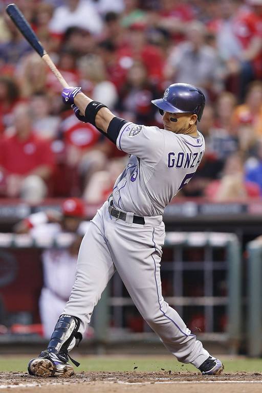 . Carlos Gonzalez #5 of the Colorado Rockies hits his second home run of the game in the fourth inning against the Cincinnati Reds at Great American Ball Park on June 5, 2013 in Cincinnati, Ohio. (Photo by Joe Robbins/Getty Images)