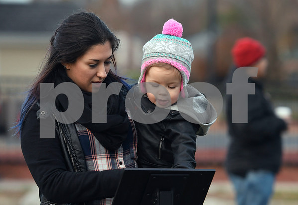 11/25/2017 Mike Orazzi   Staff Candra Civale and her daughter Alexia, 20 months, during the Town of Berlin Fire Department's annual tree lighting at the Veteran's Memorial Park Saturday evening.