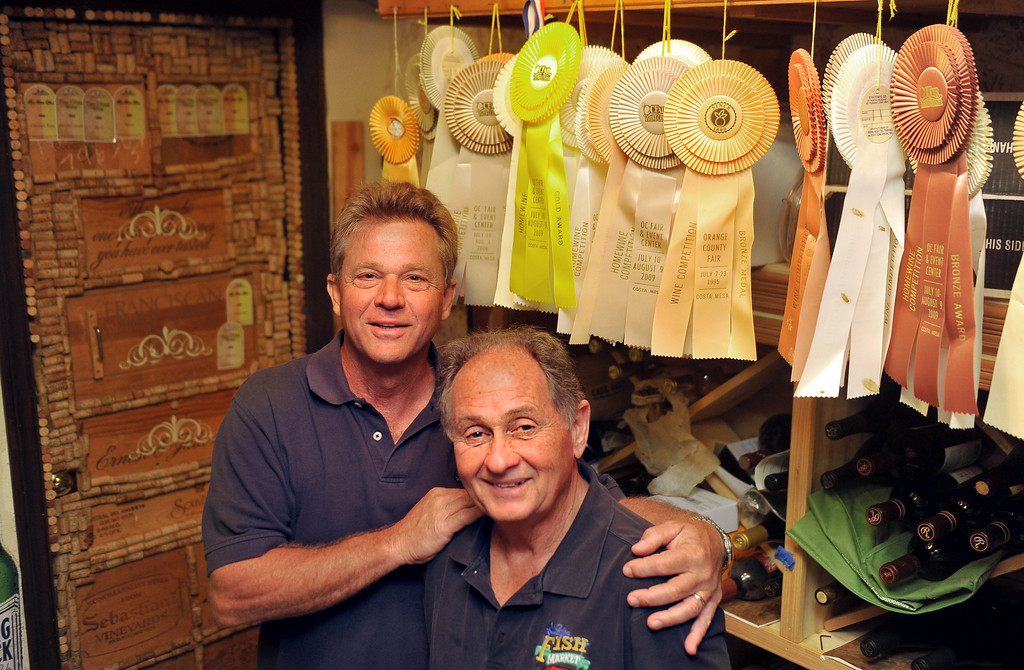 . L-R San Pedro friends Bob Nizich  and Tommy Amalfitano buy grapes in Sonoma and bring them back to San Pedro where they make wine from Bob\'s home. In a a stone cellar they keep the barrels and jugs of wine. The two have spent the past 26 years enjoying their hobby and proudly display the ribbons they\'ve won from their wines. San Pedro April 25, 2014. (Photo by Brittany Murray / Daily Breeze)