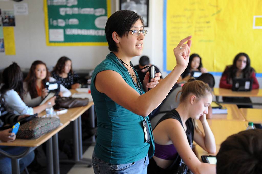 . Valley Academy of Arts & Sciences English teacher Judith Quinones gives a lesson on converting text to PDFs on an iPad, Tuesday, October 15, 2013. The Valley Academy is one of two LAUSD schools in the San Fernando Valley that are participating in the rollout of the iPad plan. (Photo by Michael Owen Baker/L.A. Daily News)