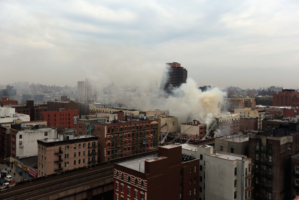 . Smoke rises from a five-alarm fire and building collapse at 1646 Park Ave in the Harlem neighborhood of Manhattan March 12, 2014 in New York City.   (Photo by Justin Heiman/Getty Images)