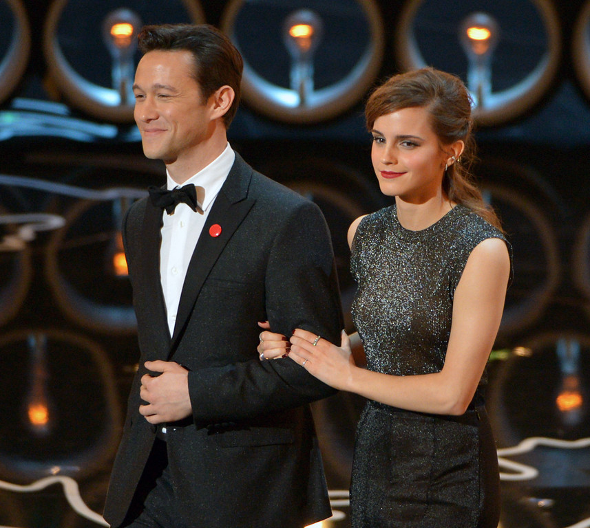 . Presenters Joseph Gordon-Levitt, left, and Emma Watson walk on stage during the Oscars at the Dolby Theatre on Sunday, March 2, 2014, in Los Angeles.  (Photo by John Shearer/Invision/AP)
