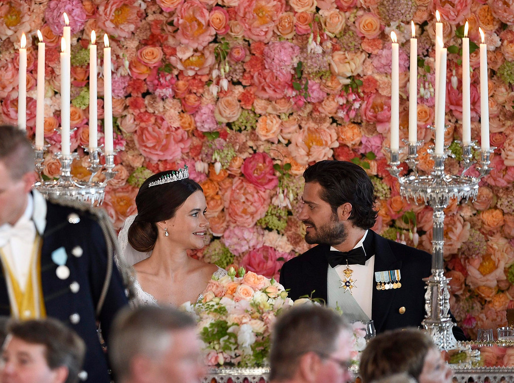 . Sweden\'s Prince Carl Philip, right, looks at Princess Sofia, during the wedding dinner at the Royal Palace, in Stockholm, Saturday, June 13, 2015, after their wedding ceremony. The only son of King Carl XVI Gustaf and Queen Silvia has married his Swedish fiancee in a lavish ceremony in Stockholm. Prince Carl Philip and the former reality starlet and model Sofia Hellqvist, 30, tied the knot Saturday at the Royal Palace chapel before five European queens, a Japanese princess and dozens of other blue-blooded guests. (Anders Wiklund/TT, via AP)