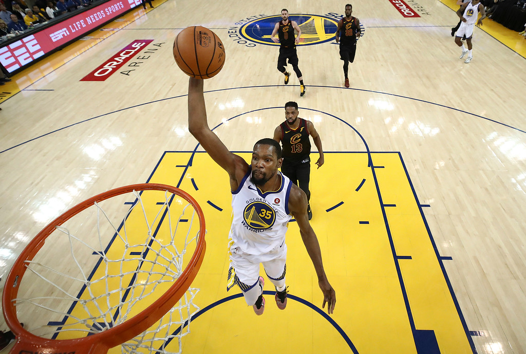 . Golden State Warriors forward Kevin Durant (35) dunks against the Cleveland Cavaliers during the first half of Game 1 of basketball\'s NBA Finals in Oakland, Calif., Thursday, May 31, 2018. (Ezra Shaw/Pool Photo via AP)