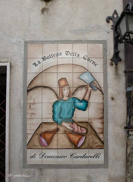 Imaginative butcher shop sign.