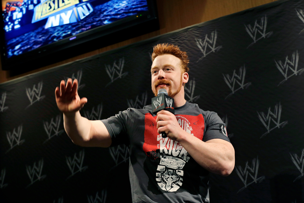 Description of . Stephen Farrelly, of Ireland, known as Sheamus, answers a question during a news conference before the WWE Wrestlemania 29 wrestling event, Sunday, April 7, 2013, in East Rutherford, N.J. (AP Photo/Mel Evans)