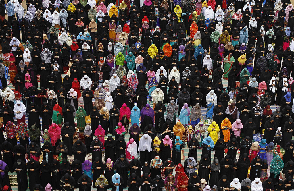 . Indian Muslim women offer prayers on Eid al-Fitr in Chennai, India, Friday, Aug. 9, 2013. Eid al-Fitr marks the end of the holy month of Ramadan, during which Muslims all over the world fast from sunrise to sunset. (AP Photo/Arun Sankar K.)