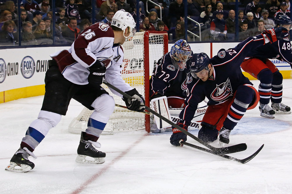 . Sergei Bobrovsky #72 of the Columbus Blue Jackets makes a save as Tim Erixon #20 of the Columbus Blue Jackets pressures Paul Stastny #26 of the Colorado Avalanche during the third period on March 3, 2013 at Nationwide Arena in Columbus, Ohio. Columbus defeated Colorado 2-1 in overtime. (Photo by Kirk Irwin/Getty Images)