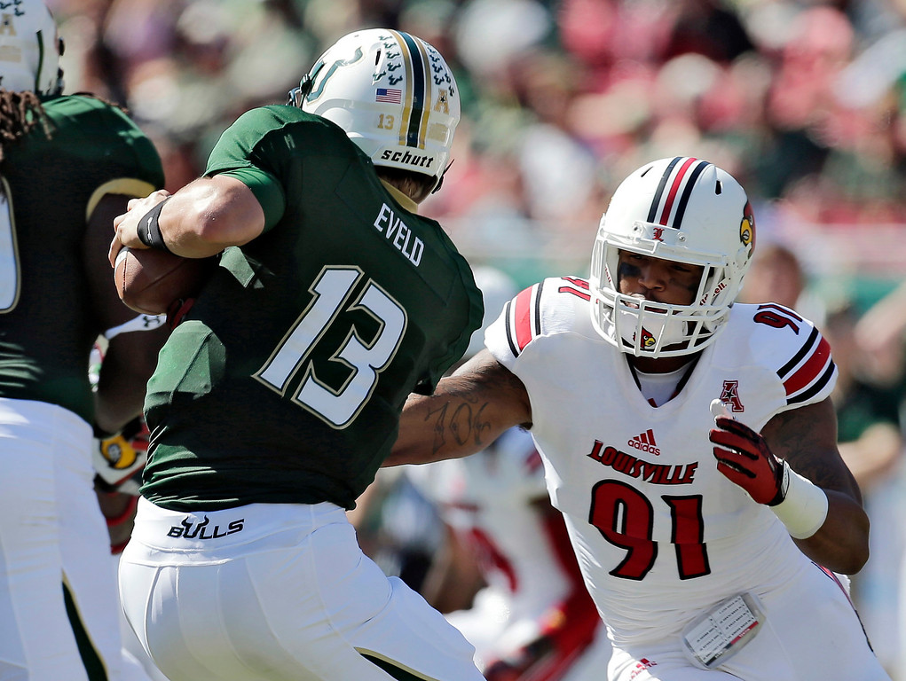 . In this Oct. 26, 2013, file photo, Louisville defensive end Marcus Smith (91) sacks South Florida quarterback Bobby Eveld (13) during the first quarter of an NCAA college football game in Tampa, Fla. Smith was selected in the first round, 26th overall, by the Philadelphia Eagles in the NFL draft on Thursday, May 8, 2014.  (AP Photo/Chris O\'Meara, File)