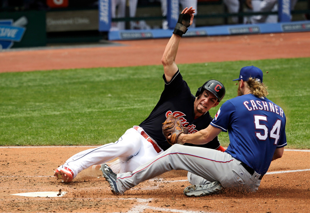 . Cleveland Indians\' Bradley Zimmer slides safely into home plate as Texas Rangers starting pitcher Andrew Cashner is late on the tag in the third inning of a baseball game, Thursday, June 29, 2017, in Cleveland. Zimmer scored on a a wild pitch by Cashner. (AP Photo/Tony Dejak)