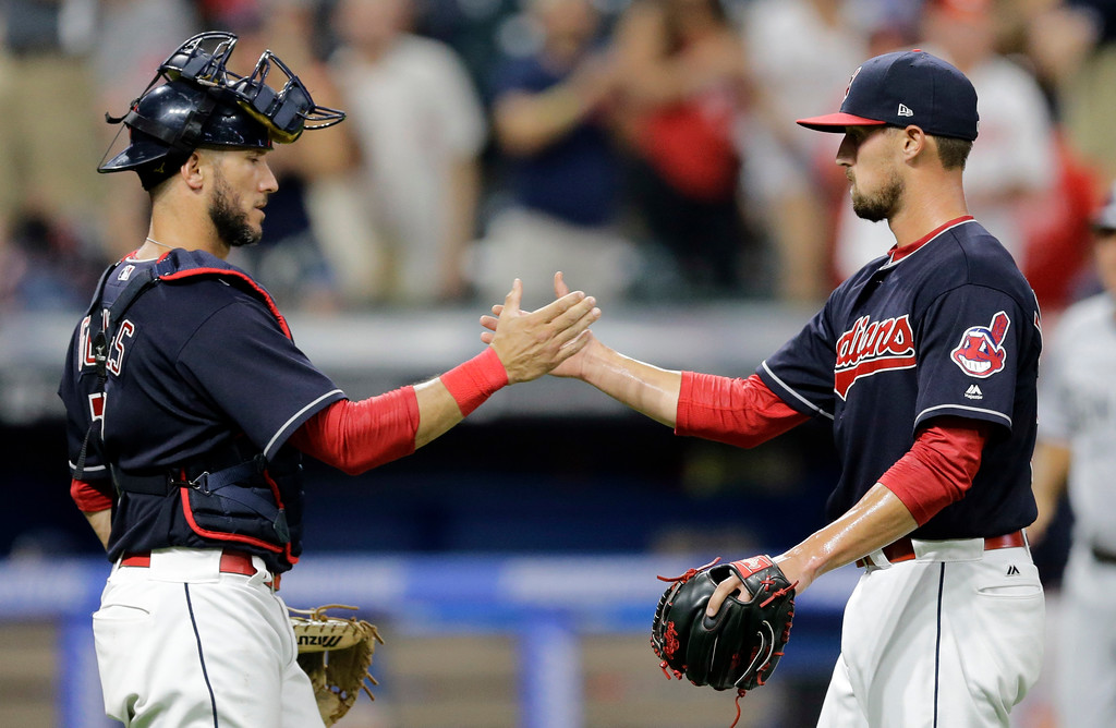 . Cleveland Indians\' Yan Gomes, left, and relief pitcher Shawn Armstrong celebrate after the Indians defeated the San Diego Padres 11-2 in a baseball game, Thursday, July 6, 2017, in Cleveland. (AP Photo/Tony Dejak)