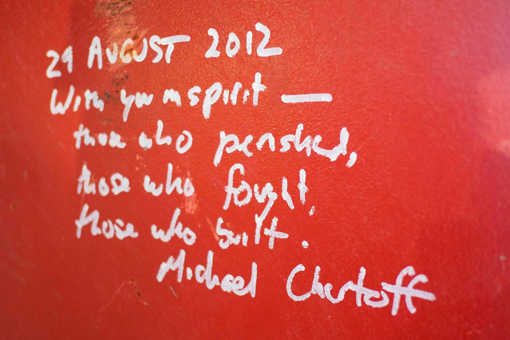 Description of . This Jan. 15, 2013 photo shows graffiti left by Michael Chertoff, the former director of Homeland Security, on a steel column on the 104th floor of One World Trade Center in New York. Construction workers finishing New York's tallest building at the World Trade Center are leaving their personal marks on the concrete and steel in the form of graffiti. (AP Photo/Mark Lennihan)